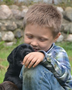 Junior with puppy.